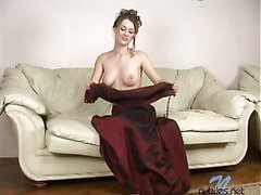 Nude breasty blond dildoing herself in her daybed