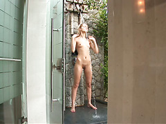Voluptuous solo babe Sasha Blonde is masturbating in the shower