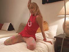 Gorgeous Sasha Blonde in panties is showing her astonishing tits