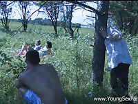 Amazing foursome where two prurient men fucking two chicks in the field