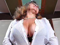 Hotie geeky lady is touching her massive and very huge melons