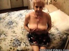 Busty Granny Stripping
