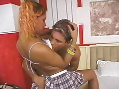 Sexy tranny schoolgirl goes into his place