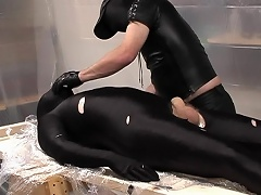 Masked and in black latex, these two gorgeous dads are really...