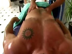 Boy gets a hard one during gay massage